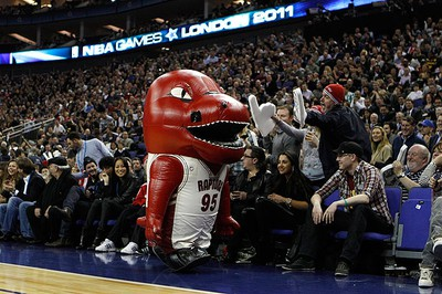 A Toronto Raptors mascot entertains fans during the third quarter of their NBA game against the New Jersey Nets in London on March 4, 2011. (REUTERS)