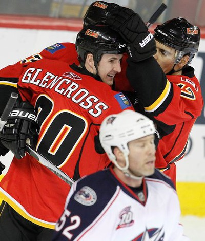 Calgary Flames Curtis Glencross,Olli Jokinen and  Rene Bourque celebrate the team's forth goal against the Columbus Blue Jackets  during NHL hockey  in Calgary, Alberta, Friday March 4, 2011. AL CHAREST/CALGARY SUN/QMI AGENCY