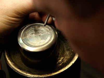 Master toolmaker Richard Hughes works on the final die of the five pound Royal Wedding commemorative coin, marking the wedding of Britain's Prince William and Kate Middleton, at the Royal Mint in Cardiff, Wales March 16, 2011.  (REUTERS/Kieran Doherty)