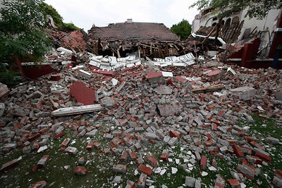 A Baptist church lies in ruins following Tuesday's earthquake in the southern New Zealand city of Christchurch February 23, 2011. REUTERS/Tim Wimborne