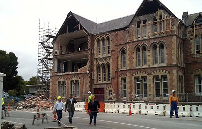 This image shows a building which was heavily damaged by a 6.3 earthquake which hit the city of Christchurch on February 22, 2011. Multiple deaths were reported as the 6.3 magnitude earthquake struck Christchurch, toppling buildings, igniting fires and sending panicked people rushing into the streets.      AFP PHOTO / SHAZ DAVIS
