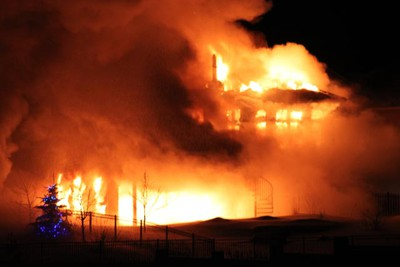A blaze ripped through a home at 35 Westwater Dr. in Royalwood Feb. 25, 2011, causing $1 million damage to the luxury abode. No injuries were reported. (ROD RUPPS/For The Winnipeg Sun)