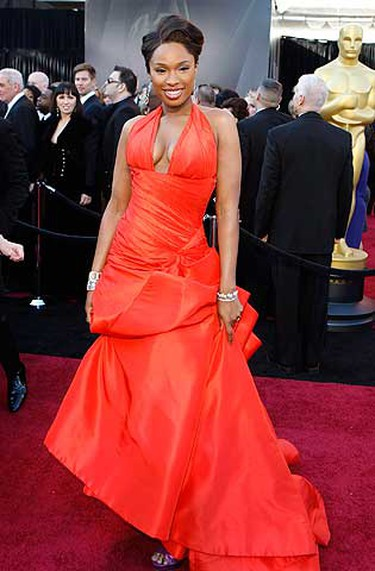 Star: Jennifer Hudson.  Grade: B. While trying to make the most of her Weight Watchers figure, Hudson didn't quite hit a high note in her tangerine Versace gown. The colour was delicious, but the halter neckline was a little too low and ended rather abruptly under the bust. Extra billows of fabric towards the hem were unnecessary - a traditionally slinky gown from the label would have sexed up the hot mamma. (Reuters/Lucas Jackson)