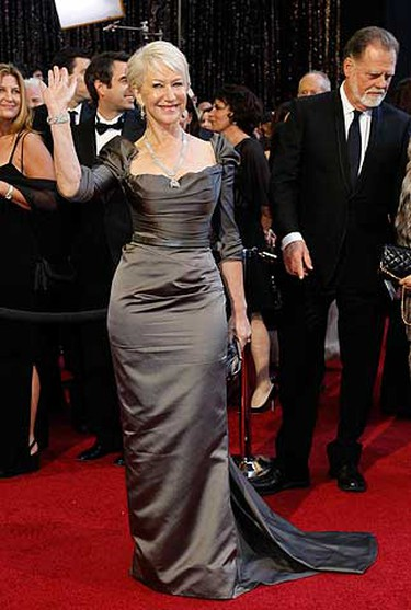 Star: Helen Mirren.  Grade: A. Considering that she has the body to pull off much younger looks, Mirren rises to the appropriate occasion every time she's photographed on the red carpet. And every woman over the age of 50 is likely breathing a sigh of relief at the sight of Mirren's sleeves on her one-of-a-kind Vivienne Westwood gown - it's about time designers know that these should be an option for all. (Reuters/Mario Anzuoni)