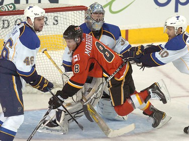 Brendan Morrison from the Calgary Flames gets hit into goalie Ben Bishop from the St Louis Blues in NHL action at the Scotiabank Saddledome in downtown Calgary, Alberta on Feb. 27, 2011. STUART DRYDEN/QMI AGENCY