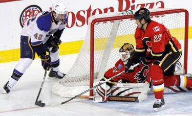 Calgary Flames Vs. St Louis Blues. David Backes 42 of the blues goes from the side to score but is blocked by Mikka Kiprusoff and Steve Staios of the Flames at the Scotiabank Saddledome in downtown Calgary, Alberta on Sunday February 27, 2011. AARON ARMISHAW/SPECIAL TO CALGARY SUN/QMI AGENCY