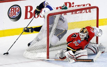 Calgary Flames Vs. St Louis Blues. Brad Winchester of the St.Louis Blues makes a play around the net and knocking the net off at the Scotiabank Saddledome  in downtown Calgary, Alberta on Sunday February 27, 2011. AARON ARMISHAW/SPECIAL TO CALGARY SUN/QMI AGENCY