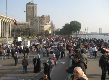 Demonstrators parade towards the state broadcaster's building on Corniche El Nile, Cairo, Egypt on Wednesday, February 2, 2011 (DAVID AKIN/ QMI AGENCY)