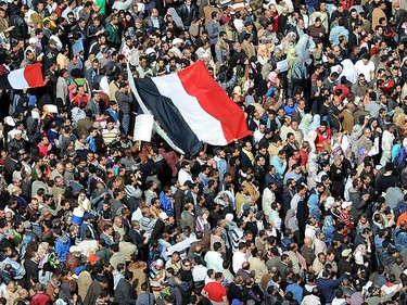 """Thousands of Egyptians gather in Cairo's Tahrir Square heeding a call by the opposition for a """"march of a million"""" to mark a week of protests calling for the ouster of Hosni Mubarak's long term regime, on February 1, 2011. AFP PHOTO/MIGUEL MEDINA"""