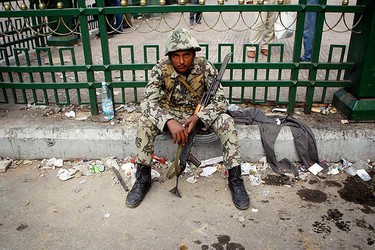 An Egyptian army soldier sits after after clashing with protesters at Tahrir Square after wide-spread protests in downtown Cairo on January 29, 2011. Egyptian President Hosni Mubarak refused on Saturday to bow to demands that he resign. (REUTERS/Amr Abdallah Dalsh)