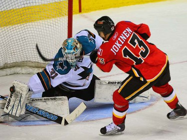 Sharks goalie Antii Niemi stops Flames Olli Jokinen in the shootout during NHL action between the Calgary Flames and the San Jose Sharks at the Scotiabank Saddledome in Calgary, AB Friday February 25, 2011. JIM WELLS/ CALGARY SUN/ QMI AGENCY