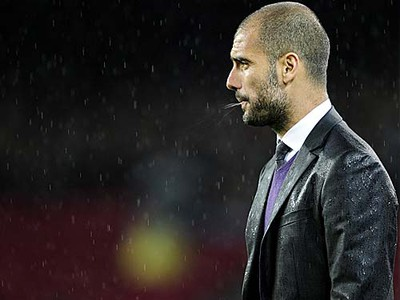 Barcelona coach Josep Guardiola spits during a Spanish League soccer match Barcelona against Tenerife at the Camp Nou stadium in Barcelona on May 4, 2010. (AFP/Josep Lago)