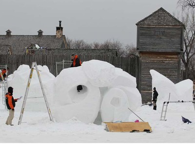 Work continues in the Voyageur Park in Whittier Park in St. Boniface Thursday in preparation for the Festival du Voyageur. (MARCEL CRETAIN/WINNIPEG SUN)