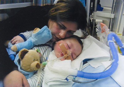 ???family handout photo???? Sana Nader of Windsor hugs her son Joseph Maraachli in hospital. Sana Nader and her husband Moe Maraachli of Windsor lost an appeal in a London court to stop doctors from removing baby Joseph Maraachili's breathing tube Thursday February 17, 2011. The family was hoping to take their terminally ill son home to Windsor for his last days.  MIKE HENSEN/THE LONDON FREE PRESS