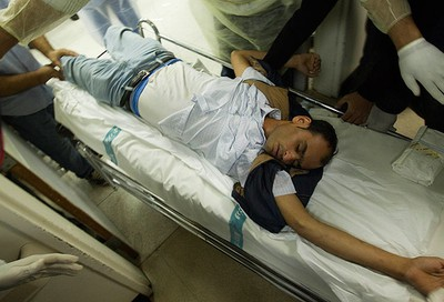 An injured man is wheeled into a treatment room at the Suleimanieh Central hospital  in Manama on Feb. 18, 2011. (REUTERS)