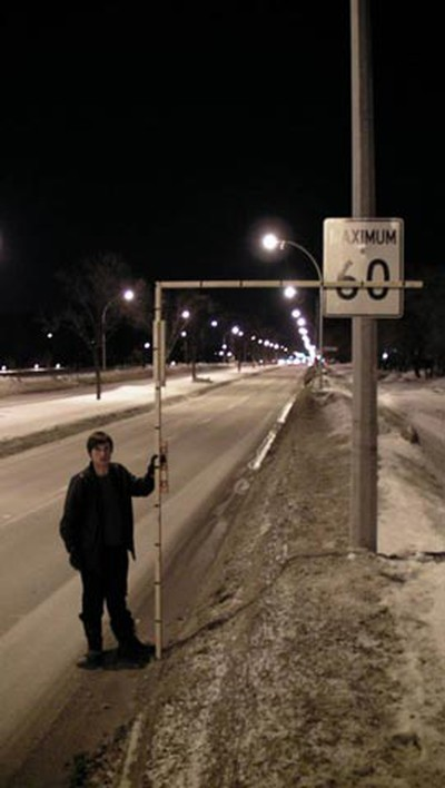 Photo showing how the posted 60 km/h speed-limit sign on westbound Grant (preceding reduced-speed sign at issue) near Pembina Hwy does comply with maximum Manual for Uniform Traffic Control Devices (MUTCD) height standards, according to WiseUp Winnipeg. (HANDOUT)