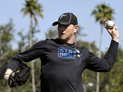 Toronto Blue Jays pitcher David Purcey throws during practice at their spring training facility in Dunedin, Fla., on Sunday, Feb. 13, 2011. (REUTERS/Mike Cassese)