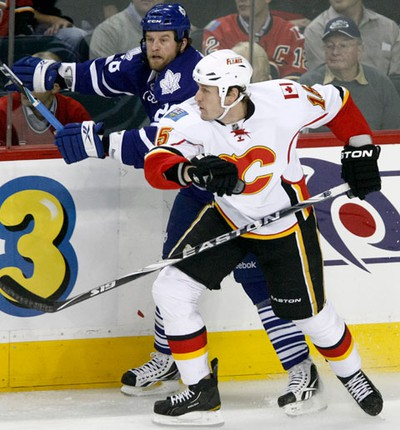 Tim Jackman of the Calgary Flames hits Colton Orr of the Toronto Maple Leafs during NHL action at the Scotiabank Saddledome in Calgary on Thursday December 16, 2010. It was former Flame Dion Phaneuf's first time back in Calgary after being traded to the Maple Leafs almost a year earlier. LYLE ASPINALL/CALGARY SUN/QMI AGENCY