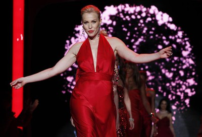 Singer Natasha Bedingfield presents a creation by Nicole Miller during the Heart Truth's Red Dress Collection 2011 Fashion Show at New York Fashion Week Feb. 9, 2011. (Jessica Rinaldi/REUTERS)
