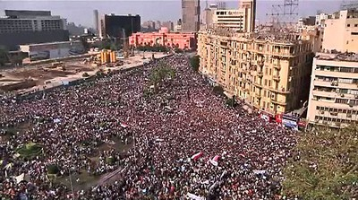 Egyptians rally at Tahrir Square in downtown Cairo in this still image taken from video February 1, 2011. More than 200,000 Egyptian men and women, from students and doctors to the urban poor, rallied in central Cairo on Tuesday in the biggest demonstration so far in an uprising against President Hosni Mubarak's 30-year rule.  REUTERS/Reuters TV