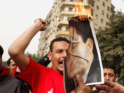 Protesters burn a picture of President Hosni Mubarak as they shout anti-goverment slogans during a demonstration in Cairo on January 29, 2011. Thousands of angry Egyptians rallied in central Cairo on Saturday to demand Mubarak resign, dismissing his offer of dialogue and calling on troops to come over to their side. (REUTERS/Asmaa Waguih)