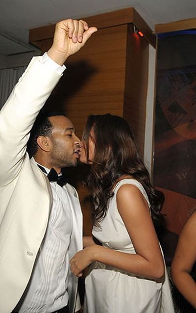 John Legend and girlfriend Christy Teigen at a New Year's Eve party in Miami, Florida on Dec. 31, 2008. (WENN.COM file photo)