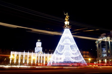 City Hall and the Freedom Monument are illuminated with Christmas decorations on the main square in Tbilisi Dec. 1, 2010. (David Mdzinarishvili/REUTERS)
