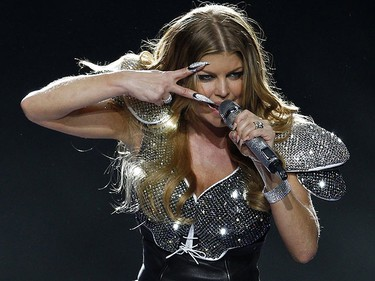 Fergie of the Black Eyed Peas performs during half-time at the NFL's Super Bowl XLV football game in Arlington, Texas, February 6, 2011. REUTERS/Brian Snyder