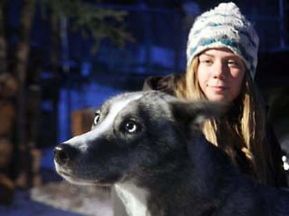 Carlin Arsenault, Director & Senior Instructor for Snowy Owl Sled Dog Tours in Canmore, shows her adopted sled dog Savannah. (DANIEL AUSTIN photo/QMI Agency)