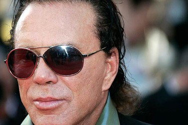 In this Sept. 30, 2010 file photo, actor Mickey Rourke smokes a cigarette outside his hotel in Paris, France. (WENN.com)
