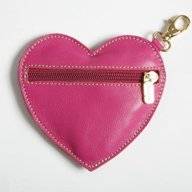 Get to the Roots of the matter and zip up your love message with a heart-shaped leather coin purse in a happy hot pink hue; $18; www.roots.com. (Courtesy of Roots)
