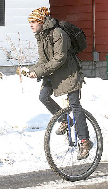 Philip Schleihauf, a second-year electrical engineering student at Queen's University in Kingston, Ont., heads towards campus on his unicycle on Jan. 31, 2011. Schleihauf said he uses the unicycle right through the winter even though it doesn't come with such options as a snow tire. (MICHAEL LEA\QMI Agency)