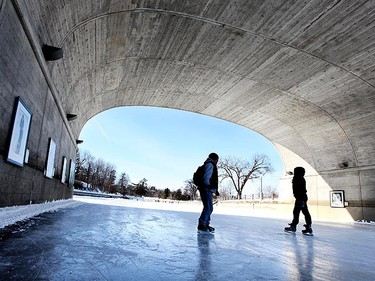 Skaters glide past a series of portraits placed on display for the public on the Rideau Canal Skateway in Ottawa, Jan 31, 2011. Portraits on the Ice is a selection of ten portrait reproductions under Bank Street Bridge on the Rideau Canal Skateway. (ANDRE FORGET/QMI Agency)