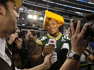 Green Bay Packers guard Adrian Battles wears a Cheese Head as he is interviewed during media day for Super Bowl XLV at Cowboys Stadium in Arlington, Texas, on Tuesday, Feb. 1, 2011. (REUTERS/Jeff Haynes)