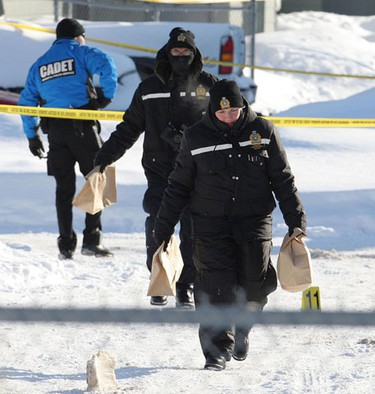 Members of the Winnipeg Police forensics unit gather evidence Saturday after a 16-year-old father was fatally stabbed about 11:30 p.m. on Friday, Jan. 28 on Allegheny Drive in Fort Richmond at an altercation outside of a party. One man, a 28-year-old neighbour, was arrested. (MARCEL CRETAIN/Winnipeg Sun)