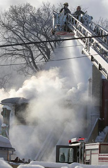 Winnipeg firefighters battle a house fire at 465 Pritchard Ave. in Winnipeg Sunday, Jan. 30, 2011. There were no known injuries in the blaze that broke out around 8 a.m. (BRIAN DONOGH/Winnipeg Sun)
