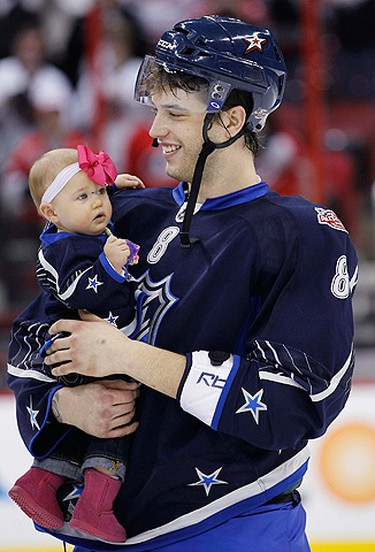 Wild defenceman Brent Burns carries his daughter Peyton after the NHL All-Star Game in Raleigh, North Carolina on January 30, 2011. (ELLEN OZIER/Reuters)
