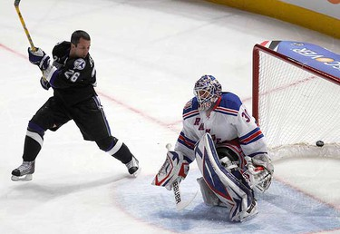 Tampa Bay Lightning forward Martin St. Louis of Team Nicklas Lidstrom scores a goal against New York Rangers goaltender Henrik Lundqvist of Team Eric Staal during the NHL All-Star hockey skills competition in Raleigh, North Carolina Jan. 29, 2011. (REUTERS/Shaun Best)