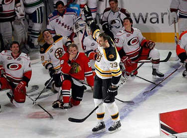 Boston Bruins defenseman Zdeno Chara of Team Eric Staal reacts after winning the hardest shot competition during the NHL All-Star hockey skills competition in Raleigh, N.C., Jan. 29, 2011. (REUTERS/Shaun Best)