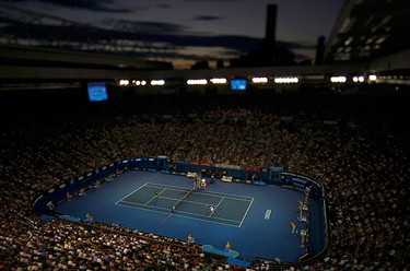 Novak Djokovic of Serbia plays a shot to Andy Murray of Britain during their men's singles final match at the Australian Open tennis tournament in Melbourne on Jan. 30, 2011. (REUTERS)