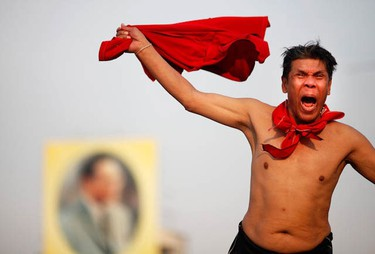 """An anti-government """"red shirt"""" protester shouts during a rally near the Democracy monument, the site of bloody clashes with security forces, in Bangkok January 23, 2011. (REUTERS/Damir Sagolj)"""