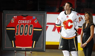 Calgary Flames Craig Conroy  with his wife Jessica celebrate his 1000th NHL hockey game before the Flames' played the Colorado Avalanche in Calgary, Alberta, Thursday, October 28, 2010. AL CHAREST/CALGARY SUN/QMI AGENCY