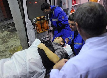 Medics wheel a victim of a bomb explosion at Domodedovo airport from an emergency vehicle into the N.V. Sklifosovsky Scientific Research Institute of First Aid in Moscow January 24, 2011. A suicide bomber killed at least 31 people and injured more than 130 on Monday at Moscow's Domodedovo airport, Russia's biggest.  REUTERS/Nikolay Korchekov