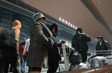 People stand outside Moscow's Domodedovo airport January 24, 2011. A suicide bomber killed at least 35 people at Russia's biggest airport on Monday in an attack that bore the hallmarks of militants fighting for an Islamist state in the north Caucasus region.  REUTERS/Denis Sinyakov