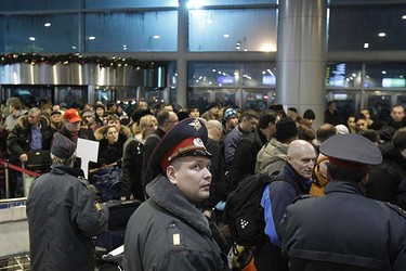 Interior Ministry officers stand guard at Moscow's Domodedovo airport January 24, 2011. A suicide bomber killed at least 35 people at Russia's biggest airport on Monday in an attack that bore the hallmarks of militants fighting for an Islamist state in the north Caucasus region.  REUTERS/Denis Sinyakov