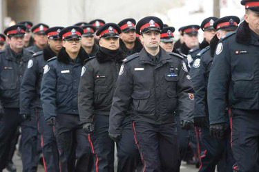 Thousands of fellow police officers from accross North America followed the hearse in silent procession on their way to the Metro Toronto Convention Centre where services were held on Tuesday, Jan. 18, 2011. (QMI AGENCY/Stan Behal)