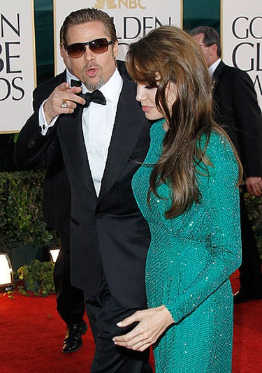 Actress Angelina Jolie, nominee for best actress for her role in the film 'The Tourist' and her partner, actor Brad Pitt, arrive at the 68th annual Golden Globes Awards in Beverly Hills, California January 16, 2011.  REUTERS/Danny Moloshok
