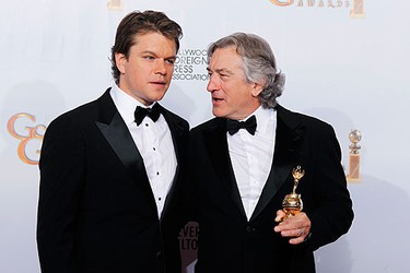 Cecil B. DeMille award recipient actor Robert DeNiro poses with his award next to presenter, actor Matt Damon (L), at the 68th annual Golden Globe Awards in Beverly Hills, California, January 16, 2011.  REUTERS/Lucy Nicholson