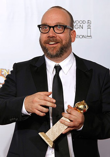 Actor Paul Giamatti poses backstage with his award for Best Performance by an Actor in a Motion Picture - Comedy Or Musical for 'Barney's Version' at the 68th annual Golden Globe Awards in Beverly Hills, California, January 16, 2011.   REUTERS/Lucy Nicholson