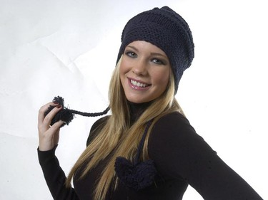 Maddison wears her navy knit hat with earflaps and pom pom detail ($34.50, EDC by Esprit, espritshop.ca). Poms, earflaps, ties and folksy wintry patterns are among the many designer-influenced details on hats this season. (Sue Reeve/QMI Agency)